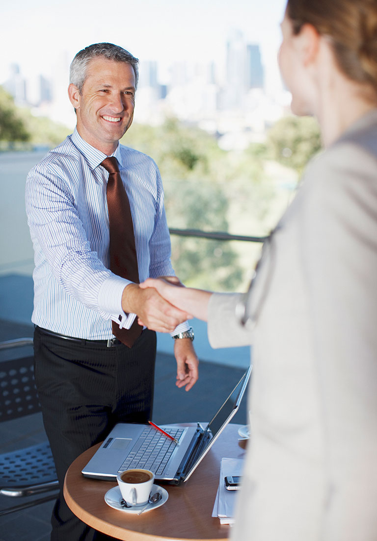 businessman-shaking-hands-with-woman
