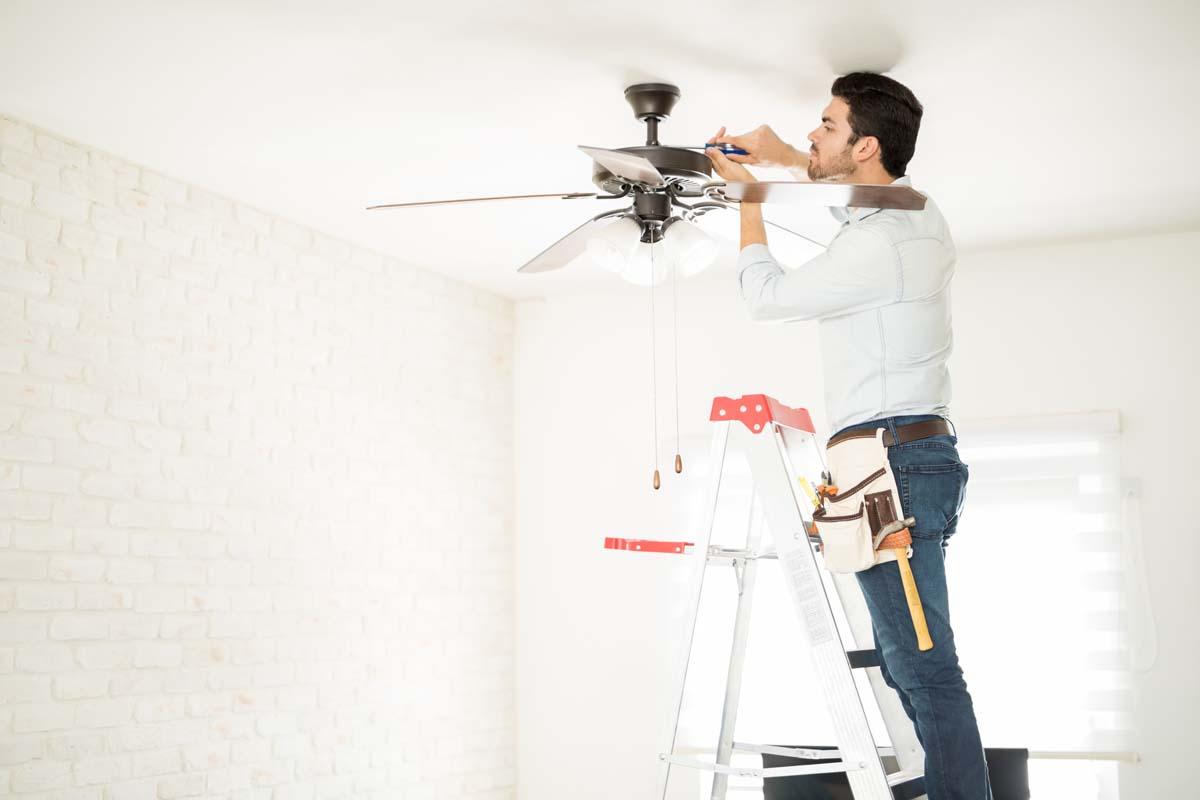 Electrician fixing a ceiling fan